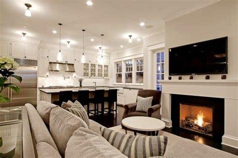 6 great reasons to love an open floor plan open floor plan white kitchen cozy fireplace love