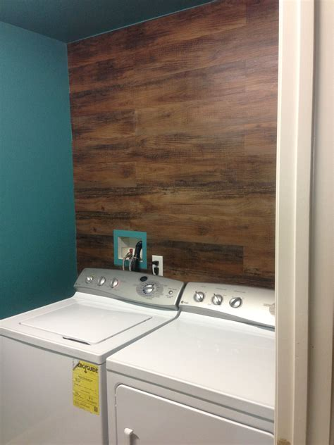 My wife used fo wood vinyl flooring on the wall! :)   For