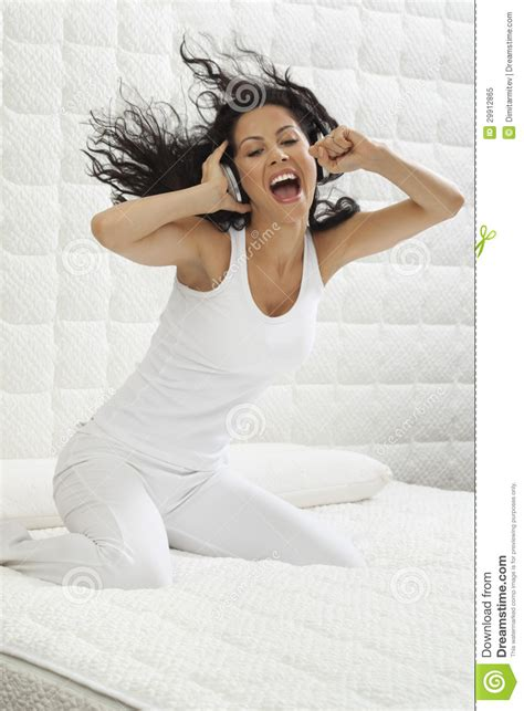 free music beds young woman listening music in bed royalty free stock photo image 29912865