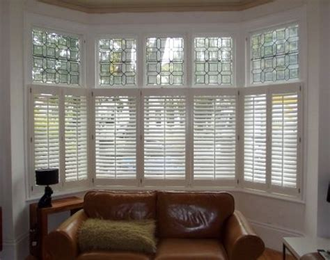Bow Window Coverings wooden plantation shutters by shutter master of london