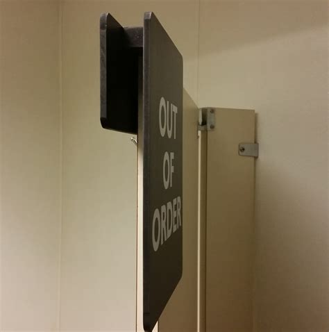 out of order restroom stall sign
