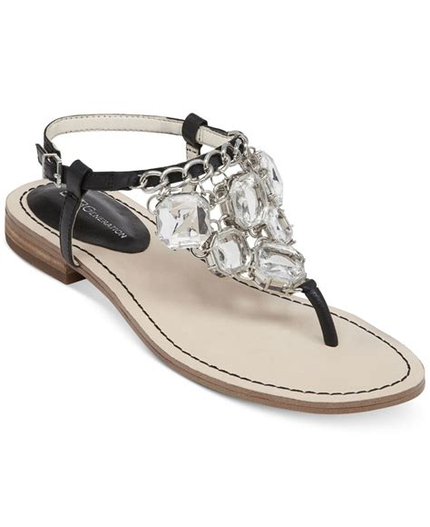 black bling sandals bcbgeneration baila bling flat sandals in black lyst