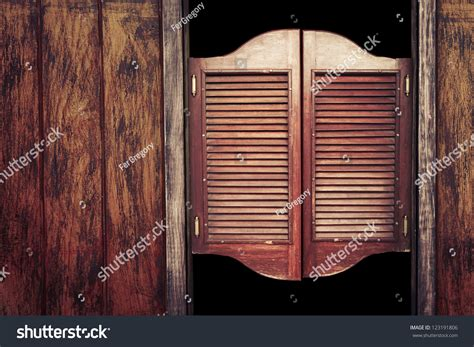 western style swinging doors old western swinging saloon doors stock photo 123191806
