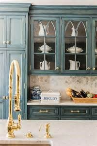 Cabinet Kitchen Hardware country kitchen features glass front cabinets accented with gold knobs