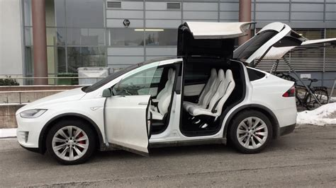 tesla model x falcon wing doors tested in tight garage