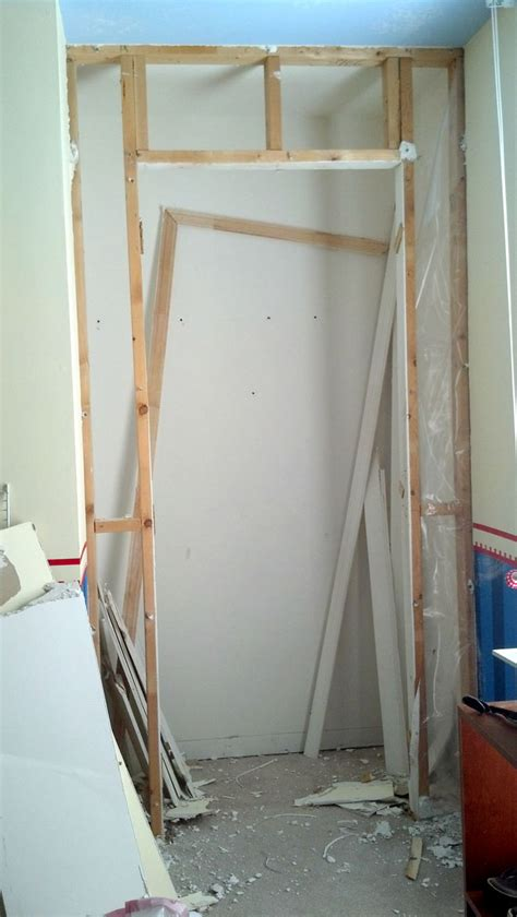 removing small interior wall  door boys room reno