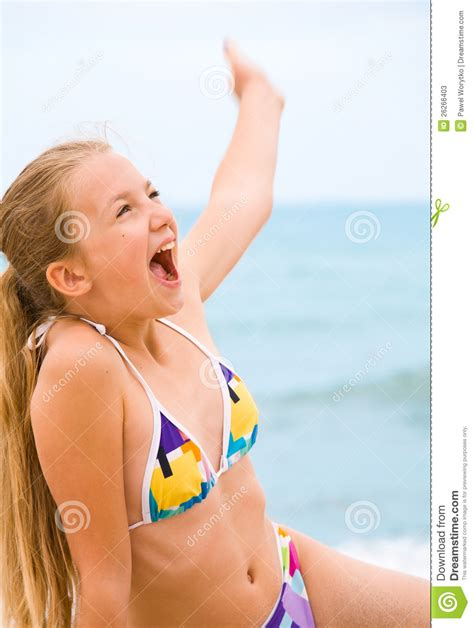 rainpow young little girls beauty young girl on the beach stock photos image 26266403