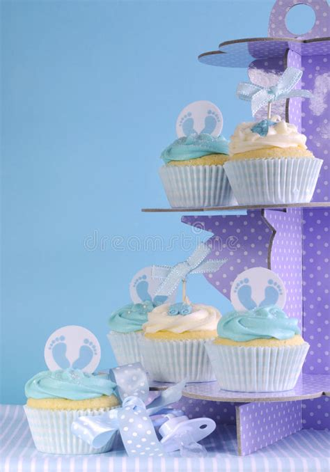 Cle1256 Piyama Baby Motif Boys New Born blue theme baby boy cupcakes on purple polka dot cupcake stand stock photo image 40717994