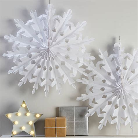 hanging snowflakes two white hanging snowflake decorations by