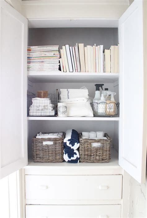 bathroom cleaning products storage organized linen closet great idea to move bathroom