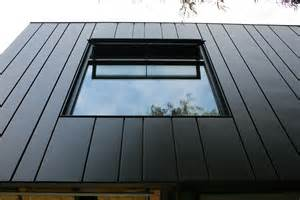 Metal Homes varying widths express panels give rhythm to any facade