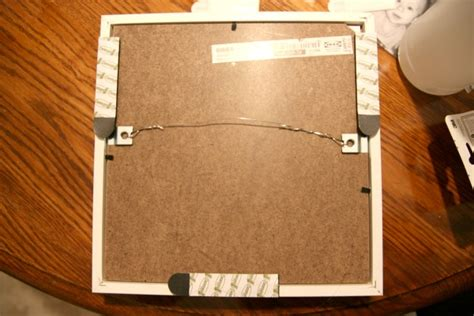 how to hang a picture frame easy diy frame hanging no nails or tape measure required