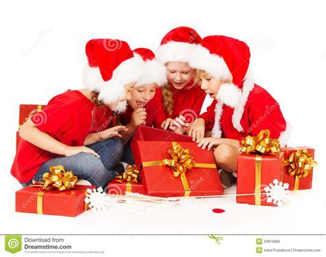 Christmas Helpers Kids In Santa Hat Opening Gift B Stock ... Happy Kids Opening Christmas Presents