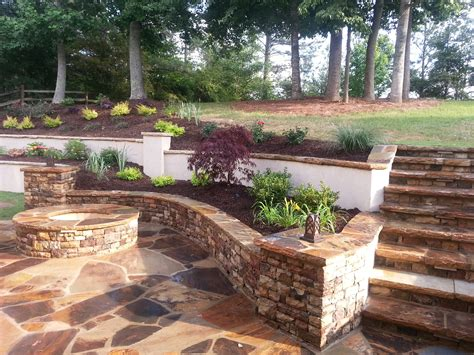 small pit and large patio forsyth landscape