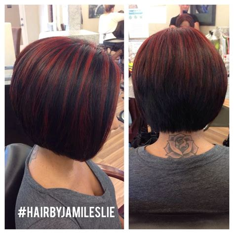 short cuts with burgundy high and low lights an adorable stacked a line bob with red highlights hair