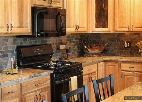 granite countertop oak kitchen cabinets slate backsplash