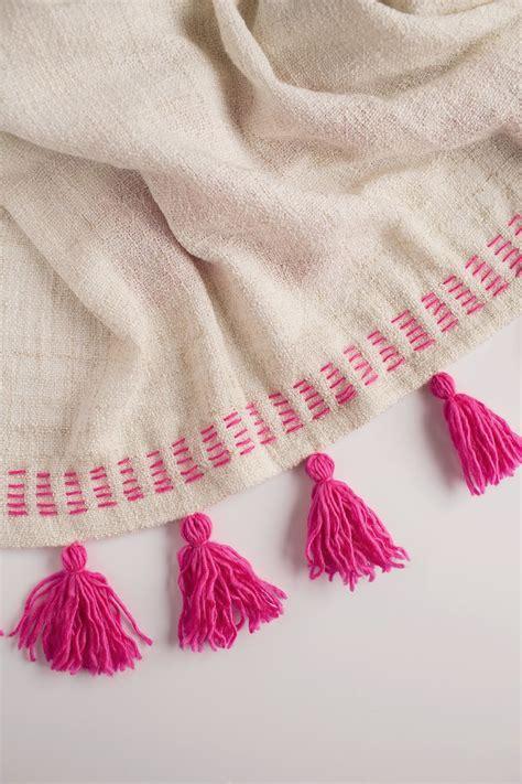 diy tassels tell diy tassel blanket tell and
