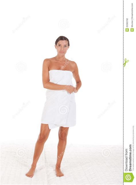 Spa Shower Bath young caucasian woman wrapped in bath towel stock
