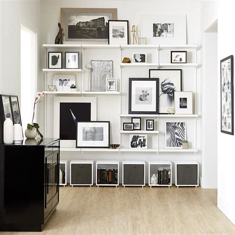dad built this living room shelf white white elfa d 233 cor shelving wall the container store