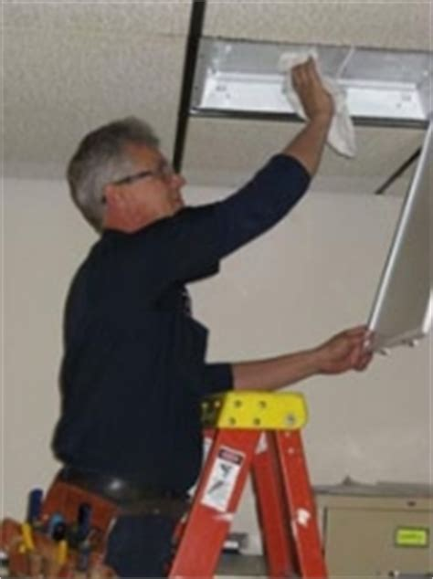 cleaning light fixtures commercial lighting management midwest light maintenance