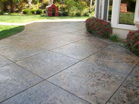 Concrete Stamped Patio by Stamped Concrete Vs Interlocking Stone Adams Landscape