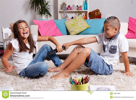 sister sucking brother heavy rcom children fighting over the remote control stock photo