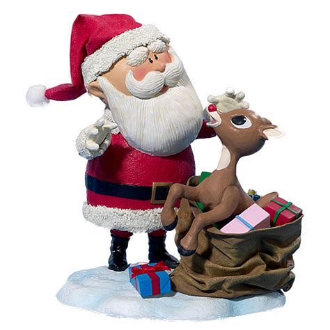 rudolph the red nosed reindeer and santa claus statue
