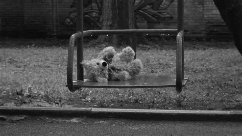 depression swings forgotten teddy bear on a swing under rain deep