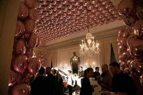 Across Ceiling by In The Room Hundreds Of Mylar Balloons Were Strung