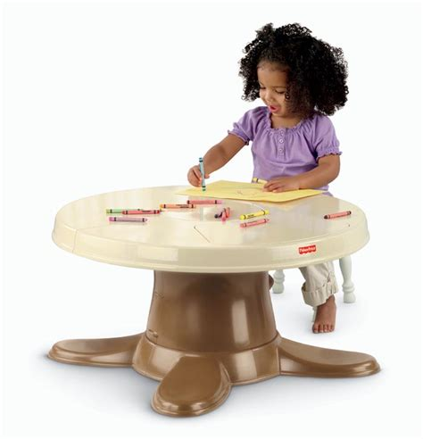 fisher price servin surprises kitchen table dress up