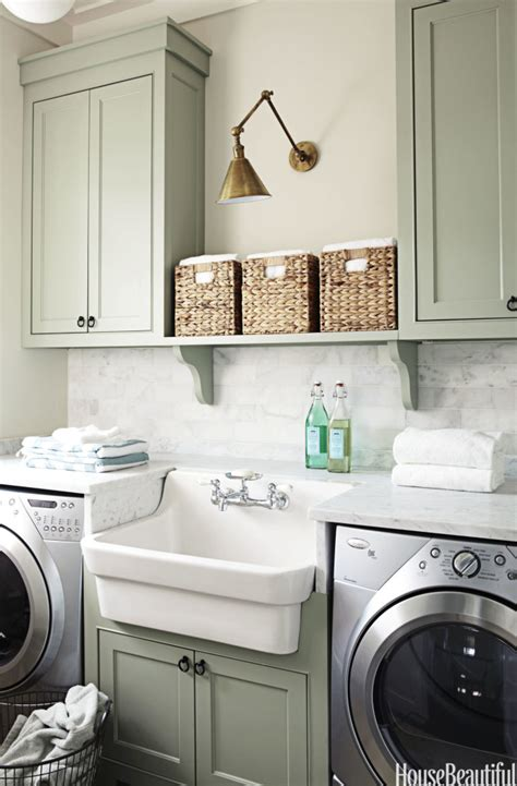 cabinets for a laundry room laundry room makeover ideas centsational