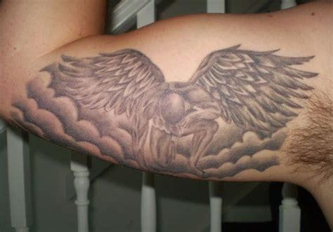 angel tattoo looking down 25 marvelous guardian angel tattoos for men creativefan