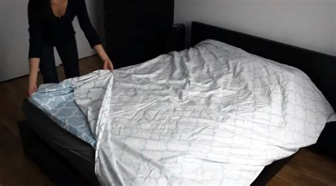 can you put duvet cover over comforter the duvet burrito how to put a duvet cover on your