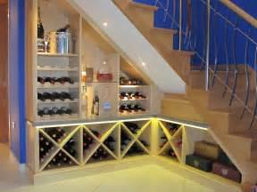 Wine bottle storage racks built under staircase and furniture wine