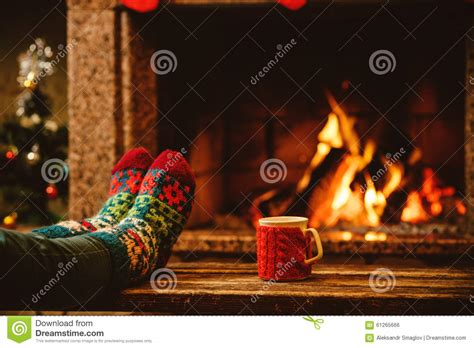 screensaver camino in woollen socks by the fireplace