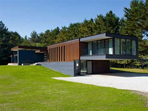 cantilever homes sustainable clearview residence overlooking a pond