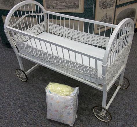 antique vintage white wicker baby bassinet on wheels