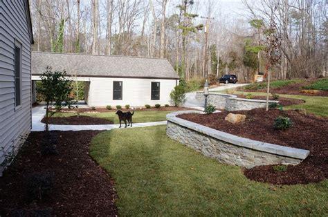 backyard slopes toward house real rock retaining wall the front yard at this home