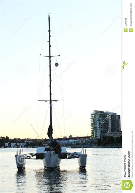 trimaran inside trimaran anchored inside of a harbor stock image image