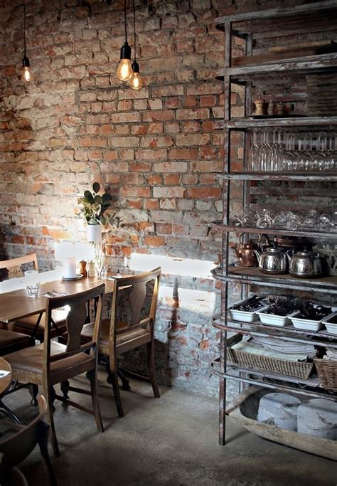 dining room with exposed brick wall industrial