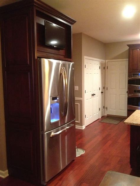 cabinet mount tv for kitchen tv mounted above refrigerator on a cabinet door that is
