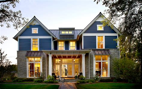 modern awning window exterior farmhouse with standing seam metal roof gable roof