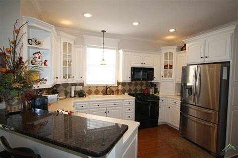 white kitchen cabinets for sale adorable cottage with front porch to sit and rock on