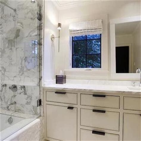 window over bathroom sink glass top washstand transitional bathroom ambiance interiors