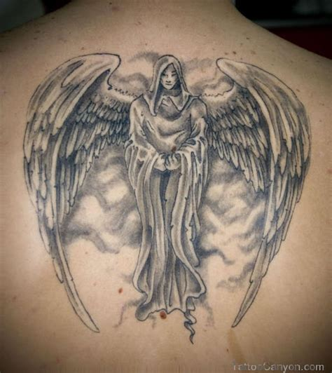 grey ink angel chest tattoo on back