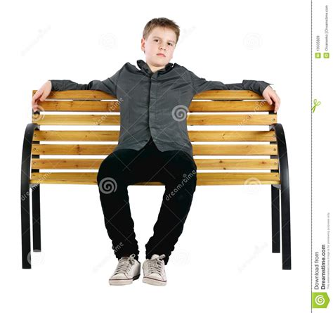 boys bench young man sitting on the bench royalty free stock photo