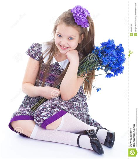 charming little models charming little girl with a bouquet of flowers stock