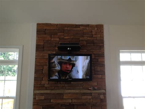 mount tv brick fireplace we specialize in fireplace tv wall mounting brick
