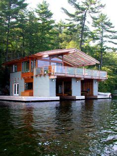 houseboat with garage boat garage on pinterest house boat interiors floating