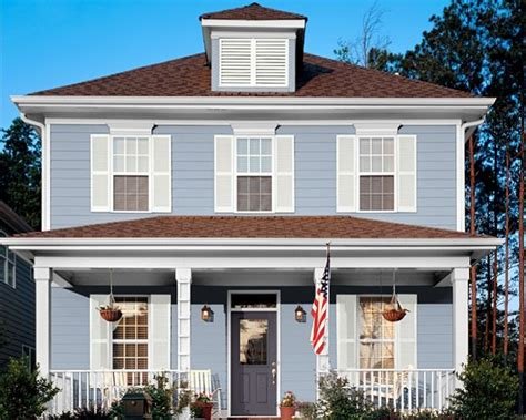 blue house white trim front door sky blue house white trim grey blue door brown roof